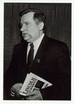 Photograph of Lech Wałęsa holding the Book, Lincoln on Democracy
