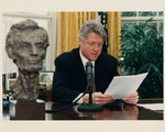 Photograph of President Bill Clinton and Lincoln Bust
